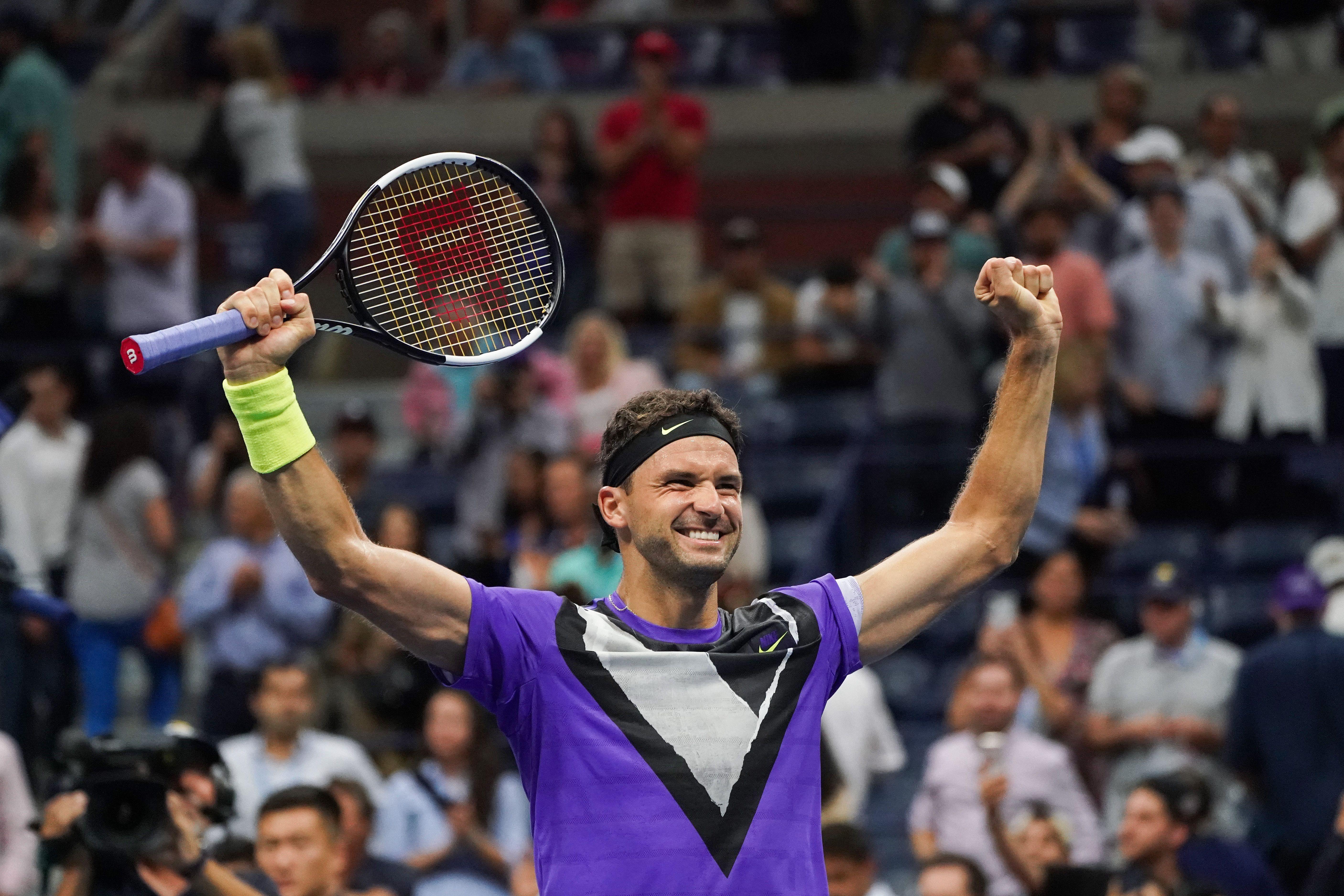 Grigor Dimitrov celebra su primera victoria ante Federer.