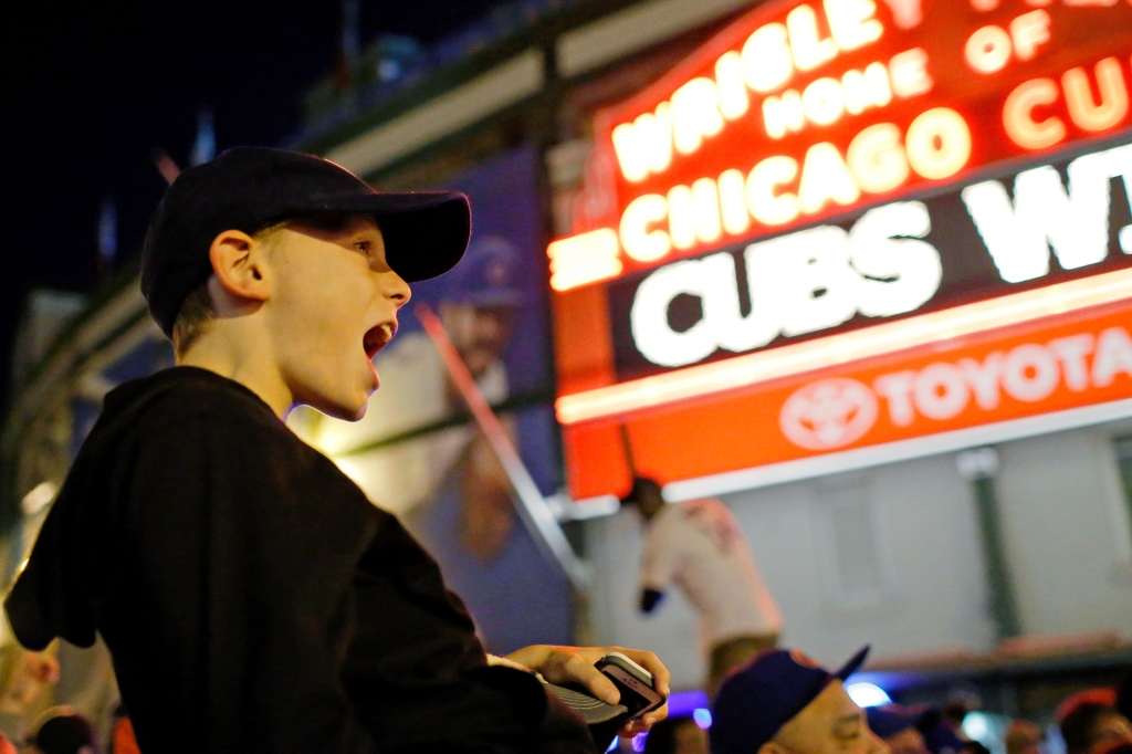 CHICAGO, IL - OCTOBER 13: Jaden Klein, 11 of Chicago, celebrates outside of Wrigley Field after the Chicago Cubs beat the St. Louis Cardinals in Game Four to win the National League Divisional Series on October 13, 2015 in Chicago, Illinois. (Photo by Jon Durr/Getty Images)