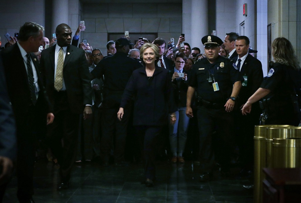 WASHINGTON, DC - OCTOBER 22: Democratic presidential candidate and former Secretary of State Hillary Clinton (C) arrives prior to testifying before the House Select Committee on Benghazi October 22, 2015 on Capitol Hill in Washington, DC. The committee held a hearing to continue its investigation on the attack that killed Ambassador Chris Stevens and three other Americans at the diplomatic compound in Benghazi, Libya, on the evening of September 11, 2012. (Photo by Alex Wong/Getty Images)