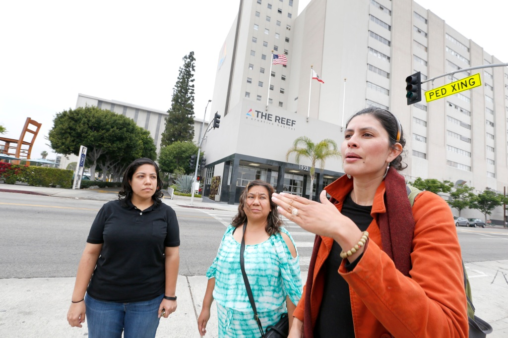 05/04/16/ LOS ANGELES/Gabriela Garcia (R), Senior Community Organizer for SAJE, community resident Lourdes Huerta, and Sandy Navarro (L), Project Coordinator for Esperanza Community Housing, speak to La Opinion in front of The Reef. Community residents and small business owners are sounding the alarmÊon the severe impacts expected from a $1 billion development Ð known as ÒThe ReefÓ. According to a new study, the gentrification caused by the proposed megaÊproject in South Central LA would harm the health of local residents and risk displacing thousands. (Photo Aurelia Ventura/ La Opinion)