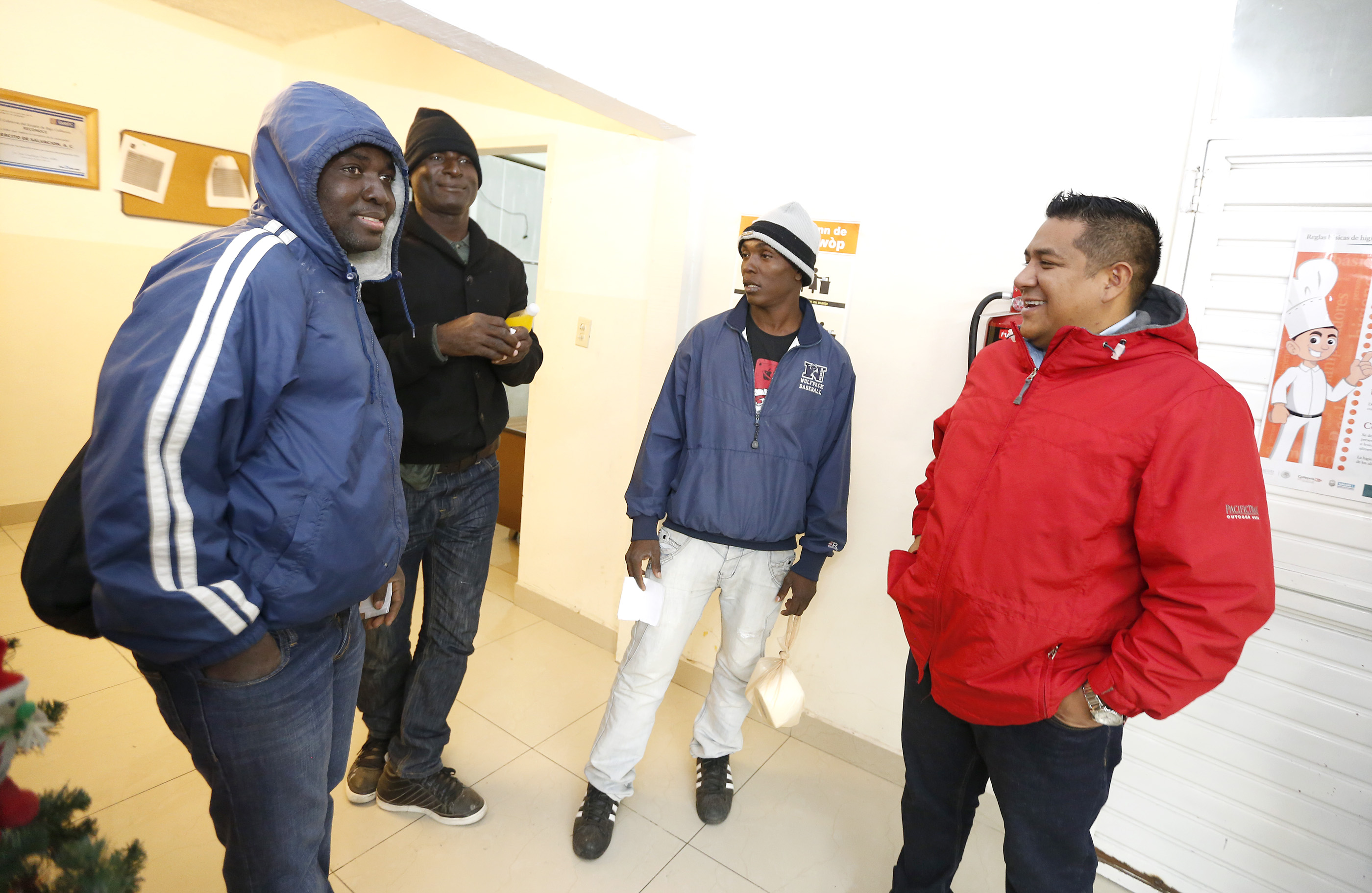 12/08/16/ TIJUANA/Capt. Isaac Olvera (R), Salvation Army in Tijuana, speaks to a group of Haitian refugees at the shelter. An unprecedented arrival of Haitians and others seeking entry into the United States in recent weeks has sent Tijuanas migrant shelters scrambling to find beds, blankets, food and other necessities to serve this increase of people awaiting processing by U.S. authorities. (Photo Aurelia Ventura/ La Opinion)