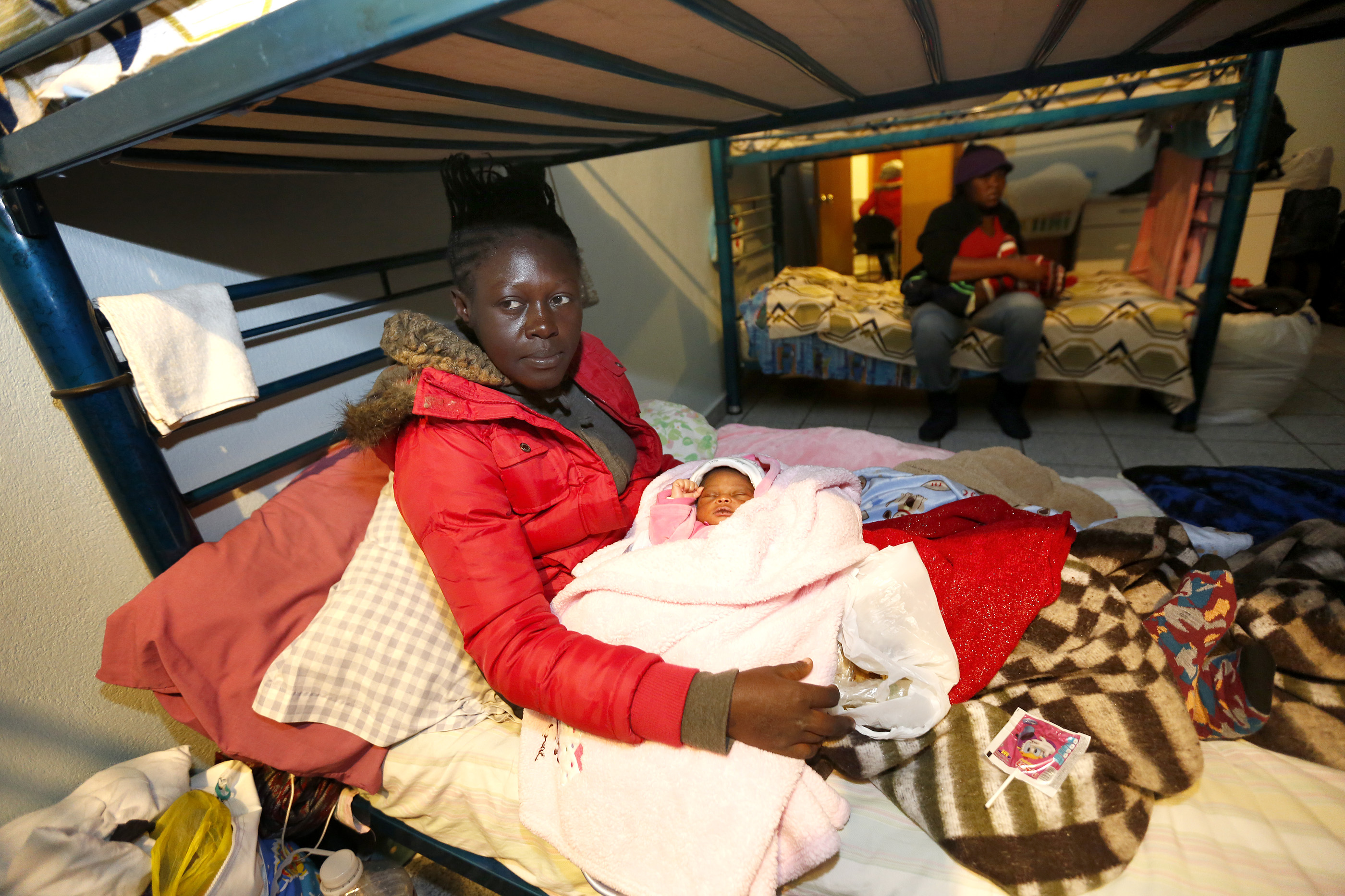 12/08/16/ TIJUANA/Haitian refugee Rosehie Su-Baptiste with her new born daughter, seek shelter at Centro Madre Assunta in Tijuana. An unprecedented arrival of Haitians and others seeking entry into the United States in recent weeks has sent Tijuanas migrant shelters scrambling to find beds, blankets, food and other necessities to serve this increase of people awaiting processing by U.S. authorities. (Photo Aurelia Ventura/ La Opinion)