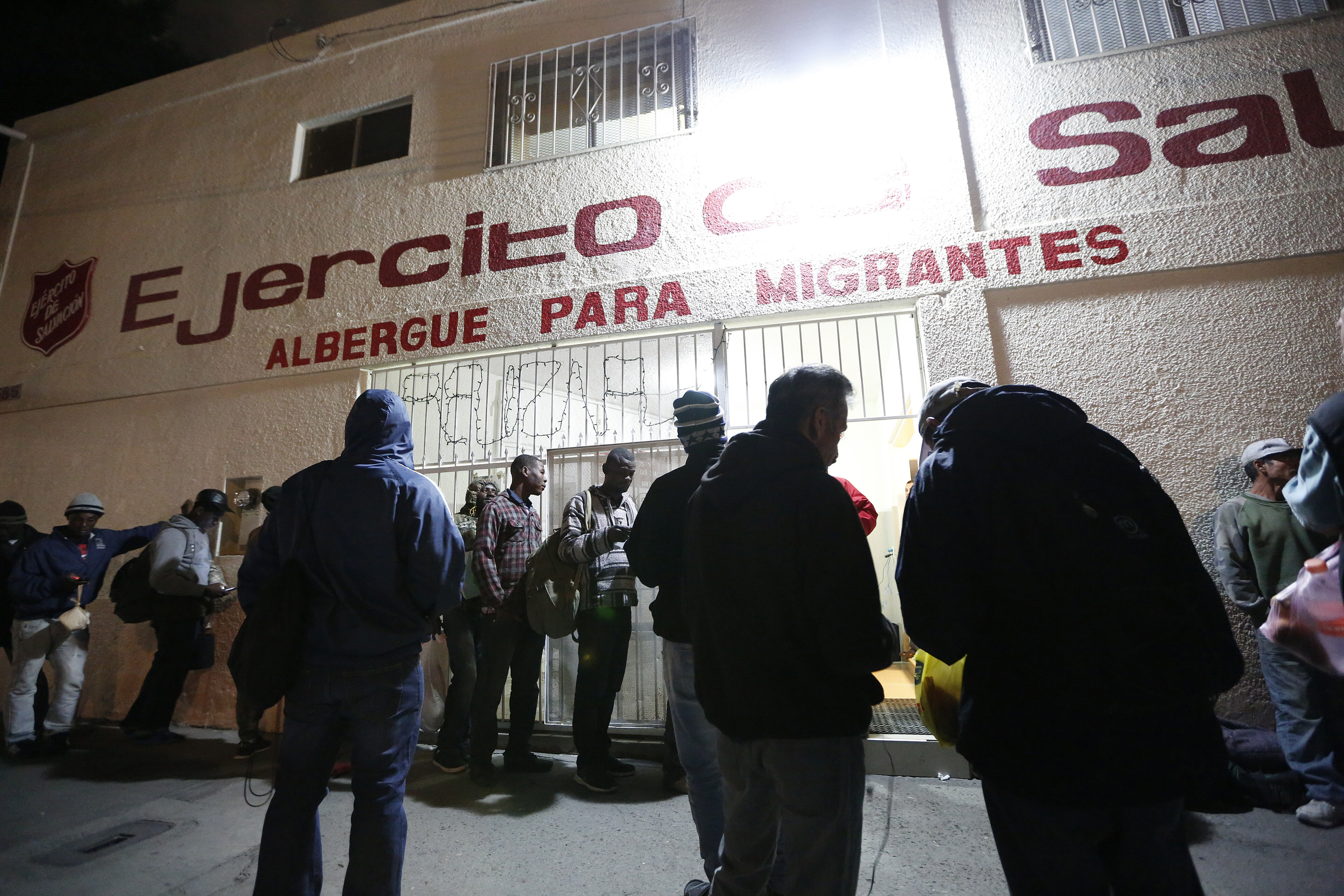 12/08/16/ TIJUANA/A large group of Haitian refugees wait to enter the Salvation Army shelter in Tijuana. An unprecedented arrival of Haitians and others seeking entry into the United States in recent weeks has sent Tijuanas migrant shelters scrambling to find beds, blankets, food and other necessities to serve this increase of people awaiting processing by U.S. authorities. (Photo Aurelia Ventura/ La Opinion)