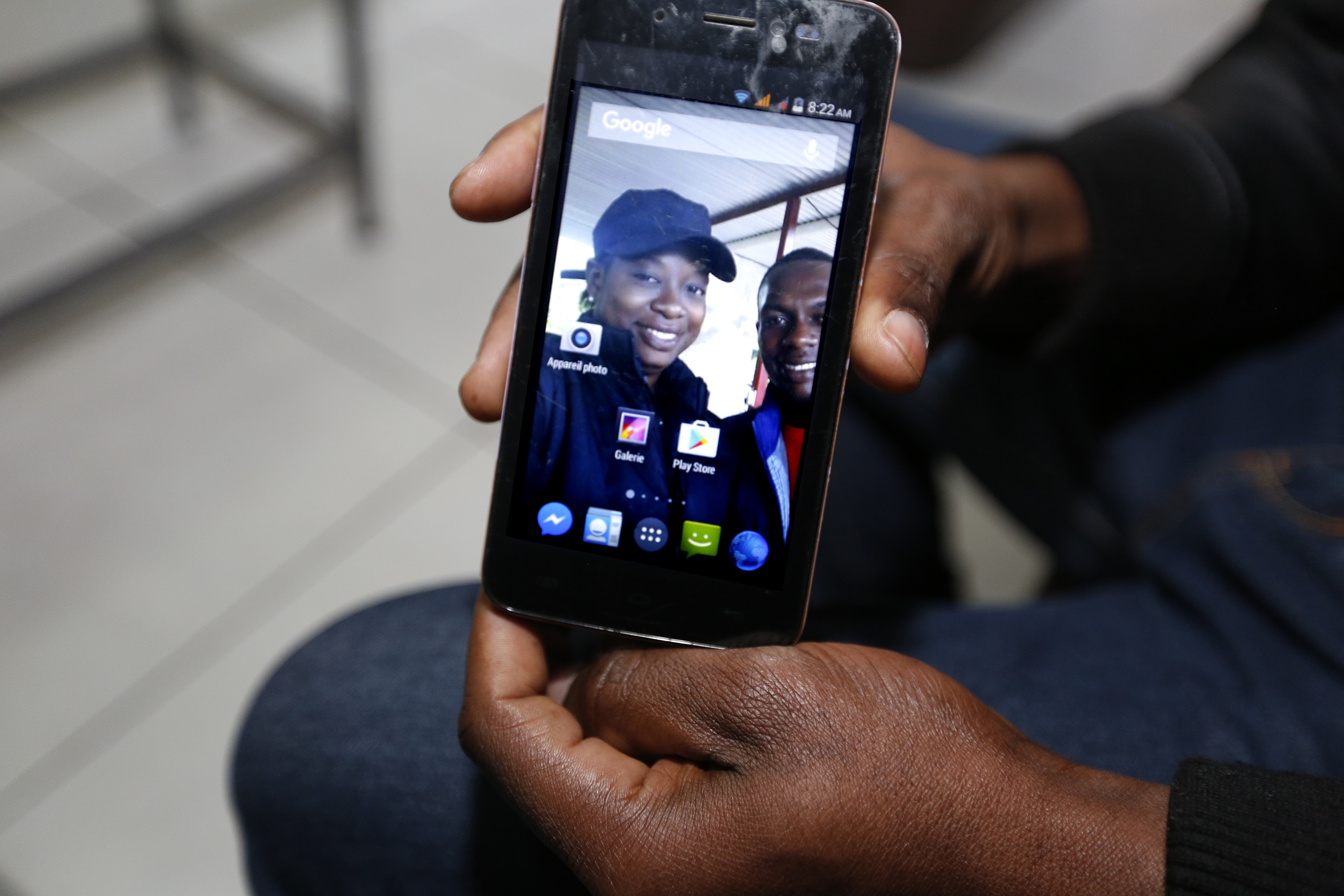 12/08/16/ TIJUANA/Haitian Lazarre John Arold shows a picture of his wife. Lazarre is among a handful of refugees who have decided to stay in Tijuana, Mexico. Haitian Lazarre John Arold receives help at the Salvation Army in Tijuana. An unprecedented arrival of Haitians and others seeking entry into the United States in recent weeks has sent Tijuanas migrant shelters scrambling to find beds, blankets, food and other necessities to serve this increase of people awaiting processing by U.S. authorities. (Photo Aurelia Ventura/ La Opinion)
