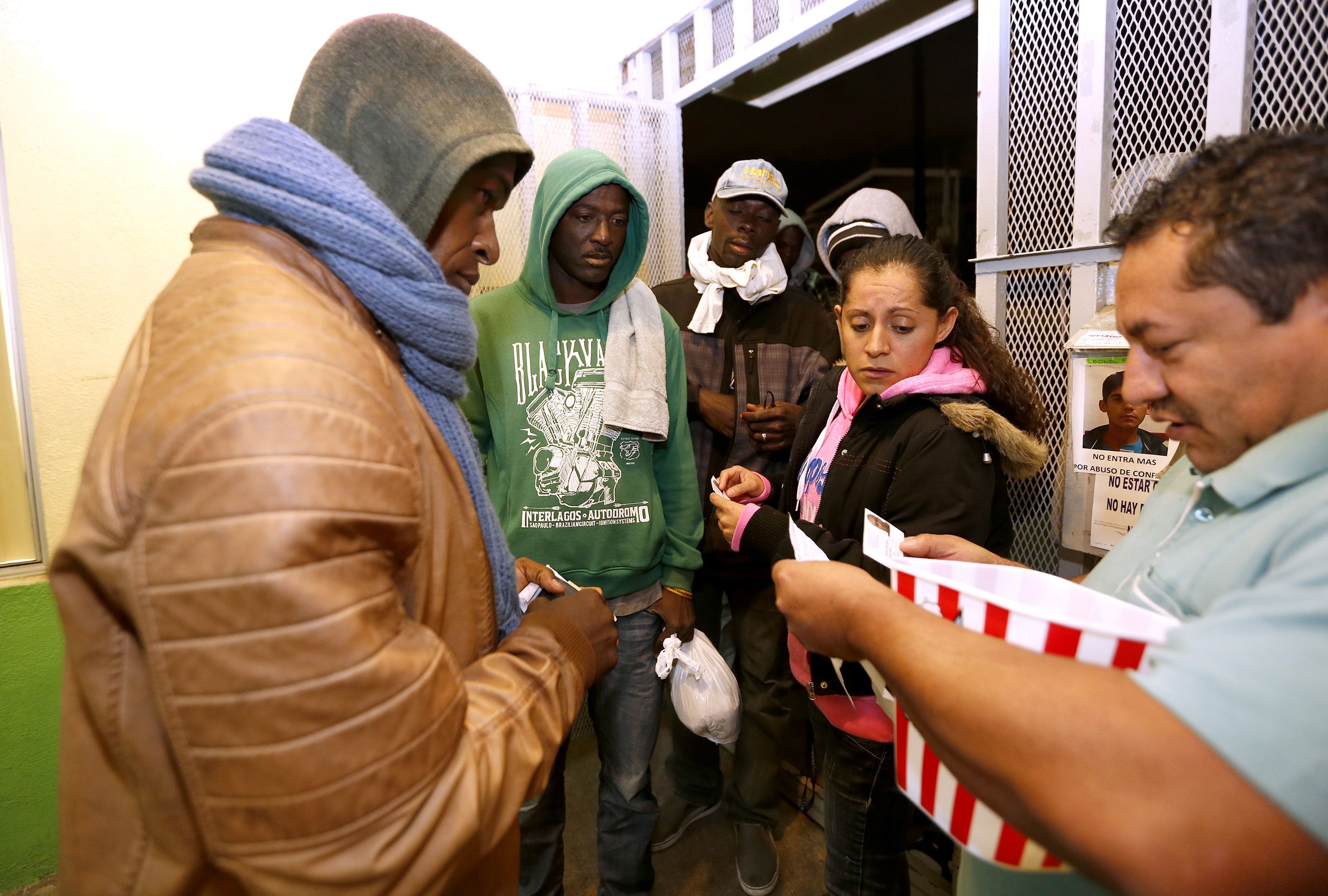 12/08/16/ TIJUANA/A large group of Haitian refugees seek shelter at the Casa del Migrante in Tijuana. An unprecedented arrival of Haitians and others seeking entry into the United States in recent weeks has sent Tijuanas migrant shelters scrambling to find beds, blankets, food and other necessities to serve this increase of people awaiting processing by U.S. authorities. (Photo Aurelia Ventura/ La Opinion)