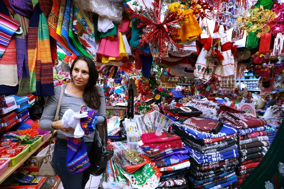12/09/16 /LOS ANGELES/Gisela, from El Sereno, shops at the popular Mercadito in East Los Angeles in preparation for the upcoming festivities of the Virgin of Guadalupe. Hundreds of religious Catholics will be celebrating the Virgin of Guadalupe. (Photo by Aurelia Ventura/La Opinion)