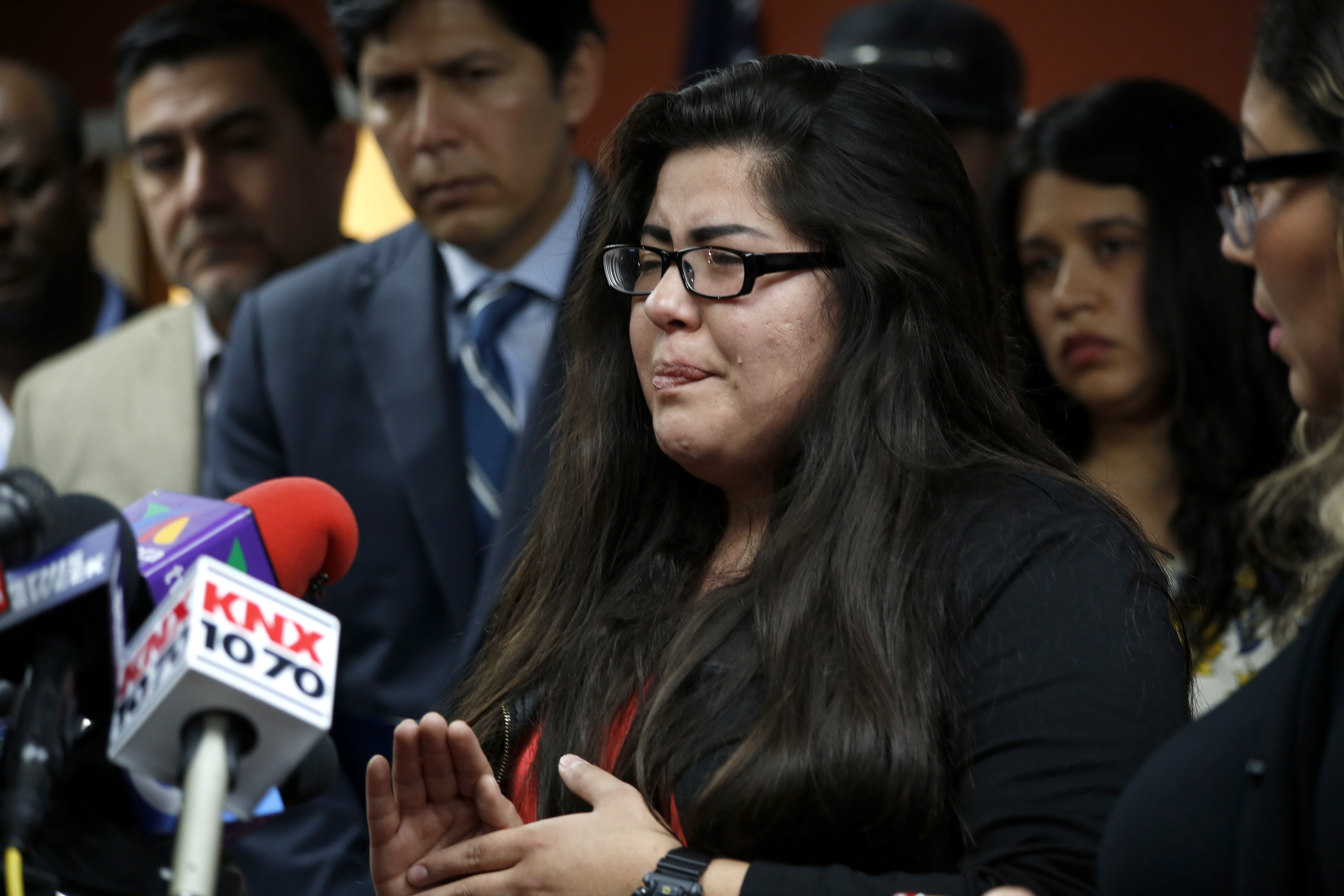 02/10/17/ LOS ANGELES/An emotional Marlene Mosqueda, 21, joined immigration advocates during a press conference at CHIRLAs Los Angeles headquarters, to express her outrage of her father, Manuel Mosque Lopez, being detained by ICE at his Van Nuys home. Immigration advocates claim more than 100 people were detained Thursday as U.S. Immigration and Customs Enforcement officials conducted home raids across three Southern California counties. (Photo Aurelia Ventura/ La Opinion)